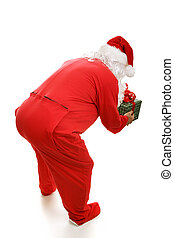 Bedtime Santa from Behind - Santa Claus in footy pajamas,...