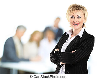 confident business woman with team behind her