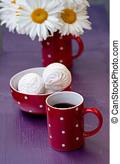 Red polka dot cup of tea, marshmallow and chamomile