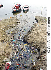 sewage water pollution channel to holy Ganges river, India -...