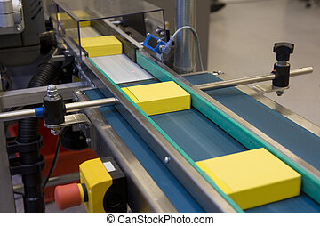 Yellow boxes production - Yellow boxes in production line