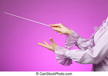 Orchestra conductor - Female orchestra conductor hands, one...