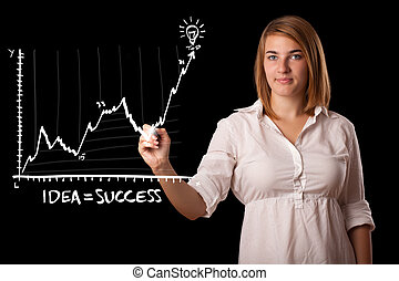 Woman drawing graph on whiteboard - Young woman drawing...