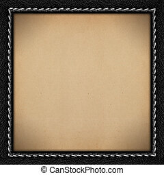 brown old paper background in black leathery frame with seam