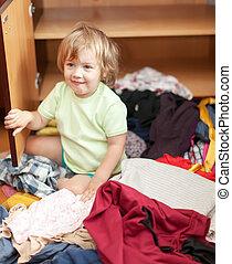 Baby girl  at closet - Baby girl  chooses dress at closet
