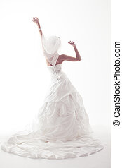 Bride in wedding white dress, back view, raised hands up. Over white