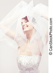 Happy bride smiling, closed eyes, carefree dreaming. Over white