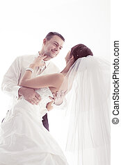 Wedding couple happy smiling and dancing Groom portrait Over...