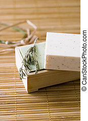 bar of herbal soap and twig of rosmary