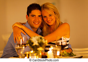 couple hugging during dinner time