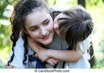 Portrait of beautiful young girls in the park .