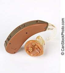 Old hearing aids. in the ear hearing aid. behind the ear...