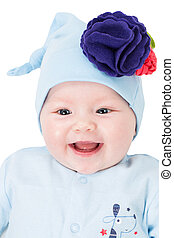 Portrait of smiling baby girl with blue eyes isolated on...