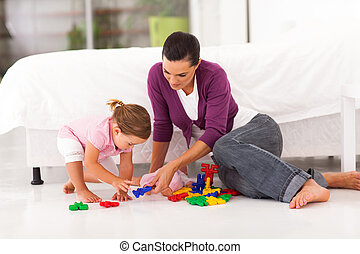 mother and daughter playing with toy