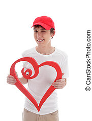 Teen with love heart cheeky wink - A teenager holding a red...