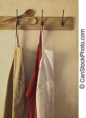 Aprons hanging on hooks with vintage feel - Kitchen aprons...