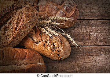 Assortment of loaves of bread on wood