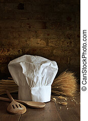 Chef hat and spoons with brick background - Chef hat and...