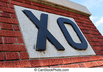 XO letters on red brick - Big letters that spell out XO on...