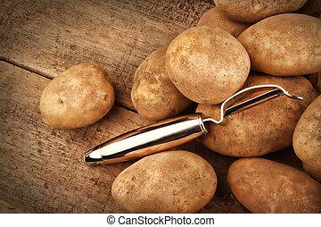 Harvest potatoes on wood