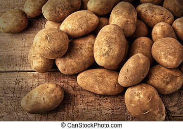Fresh potatoes on wooden background - Fresh potatoes on...