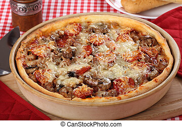 Deep Dish Pizza - Deep dish pizza with sausage, pepperoni...