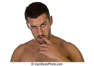 young male looking with finger in his mouth on an isolated...