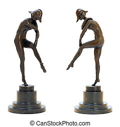 Antique bronze figurine of the sexy woman in a harlequin costume. Isolated image.
