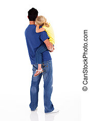 loving father carrying little daughter - rear view of loving...