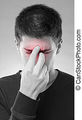 Man with sinus pain - Young man having trouble with sinus...