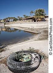 Salton sea decay - old tire and abandoned building on the...
