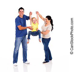 parents playing with little daughter - fun young parents...