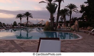 Luxurious hotel pool at sunset - Luxurious hotel pool,...