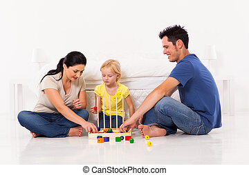 happy family playing toy