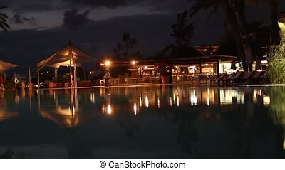 Beautiful brightly lit hotel pool a - Luxurious hotel pool,...