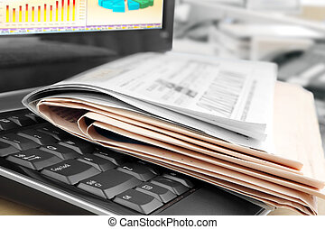Newspapers on the Keyboard - Pile of Newspapers on the...