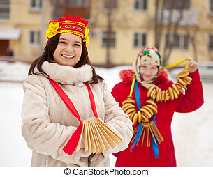 Two girls during Shrovetide - Two happy girls plays during...