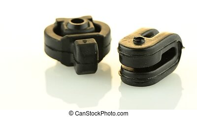 New black rubber car parts rotating on a white background