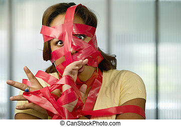 Red Tape - Businesswoman wrapped in red tape