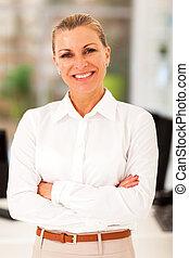 happy senior businesswoman in modern office