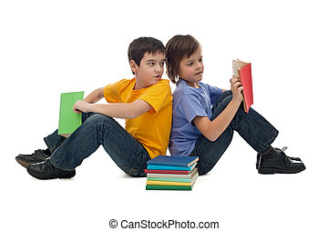 Two boys reading books - Two happy boys sitting on the floor...