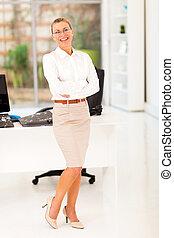 senior businesswoman full length portrait in office