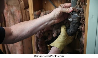 man checking broken water pipe - a man inspects the damaged...