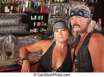 Biker Gang Couple - Serious middle aged biker gang couple at...