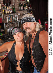 Attractive Biker Gang Couple - Attractive middle aged biker...