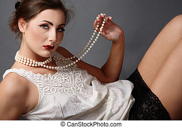 Pearl beads - Beautiful girl in white vintage blouse and...
