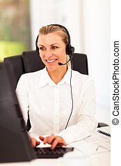 happy senior businesswoman with headphones in front of...