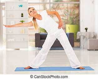 mature woman doing exercise - healthy mature woman doing...