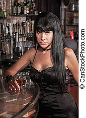 Serious Pretty Woman at Bar - Serious Caucasian woman in...