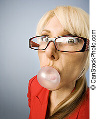 Woman in red blowing a bubble - Woman in red with glasses...